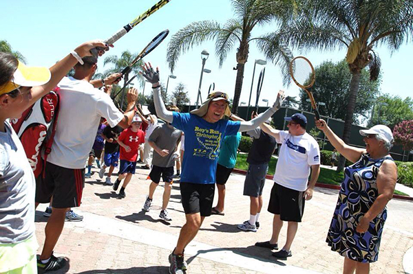 Onlookers at the Burbank Tennis Center cheer on Roy Wiegand during his July 4th Run For Christopher, during which the trumpeter and ultra-marathon  runner ran 86 miles to benefit families and children suffering from cancer.