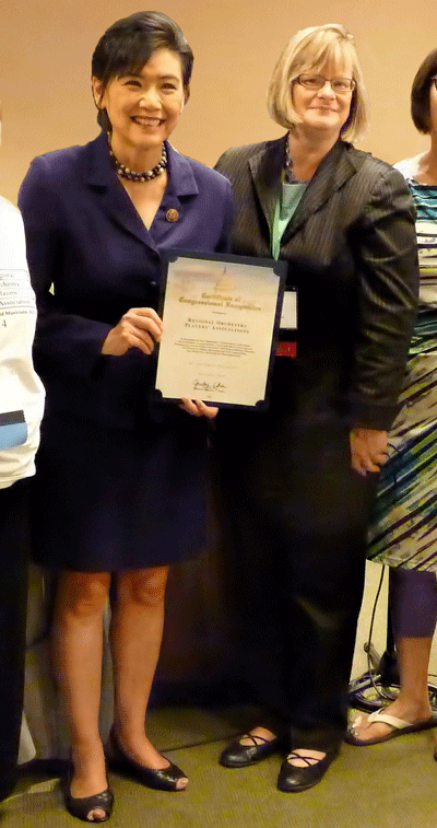 U.S. Rep. Judy Chu (D-CA, 27th District) presents ROPA President Carla Lehmeier-Tatum with a certificate of Congressional recognition.