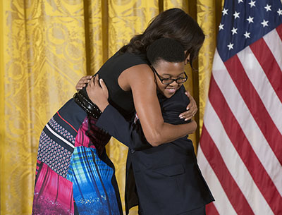First Lady Michelle Obama hugs Project STEP student Ajani Boyd. Photo: Steve E. Purcell