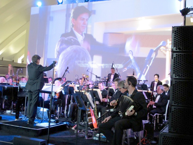 Emmanuel Fratianni conducts the 70-piece Hollywood Scoring Orchestra at the preview opening gala of the new Tom Bradley International Terminal at LAX on June 20, 2013. Photos courtesy of Laurie Robinson