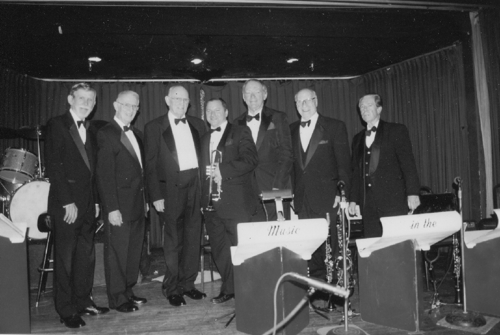 BROTHERS WHO PLAY TOGETHER STAY TOGETHER — Brothers Don and Slim performed together at the Mayflower Ballroom for 23 years until its closure in 2003. The Tanner Brothers Orchestra, pictured in March 2006 (left to right): Byron Long (piano), Slim Tanner (bass), Don Tanner (drums), Mike McGuffey (trumpet), John Bambridge (sax), Johnny Rotella (sax), and Bob Efford (sax). (Photo courtesy Slim Tanner)